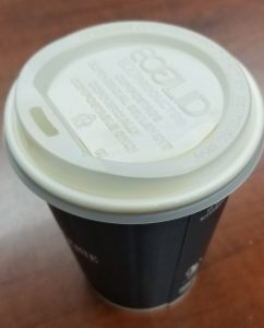 "Image of a coffee cup lid signifying ""keeping the lid"" on communications about the claims"
